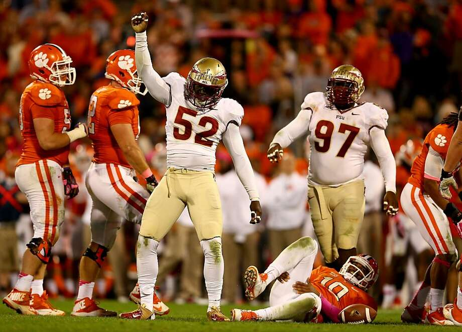 Florida State's Ukeme Eligwe (No. 52) celebrates after sacking Clemson quarterback Tajh Boyd in the first half of the visiting Seminoles' rout. Photo: Streeter Lecka, Getty Images
