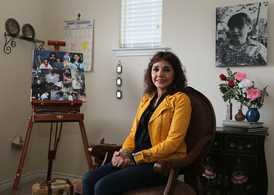 Elisheva Placeres Nawrocik sits in her late daughter Michelle Kuri's bedroom. The family has lovingly decorated the room with pink roses and other remembrances.  Photo: Jerry Lara / San Antonio Express-News