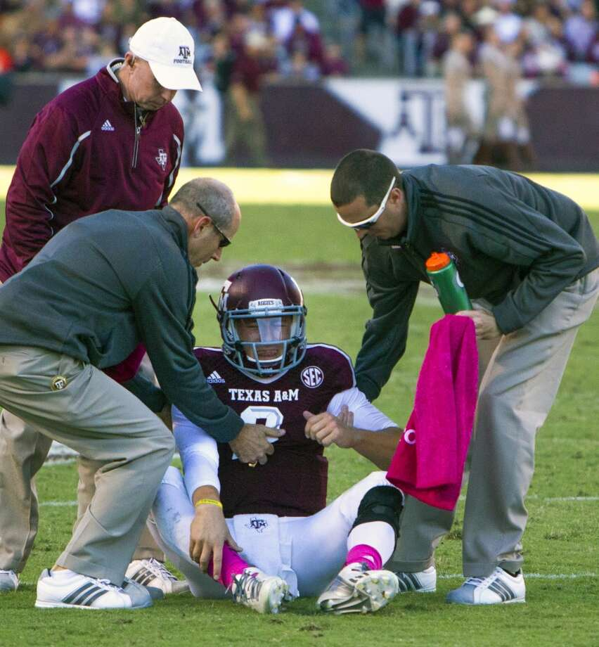 Auburn 44, Texas A&M 41Record: 5-2  Texas A&M Aggies quarterback Johnny Manziel is helped to his feet after he was injured during the fourth quarter against the Auburn at Kyle Field on Saturday, Oct. 19, 2013. Photo: Cody Duty, Houston Chronicle