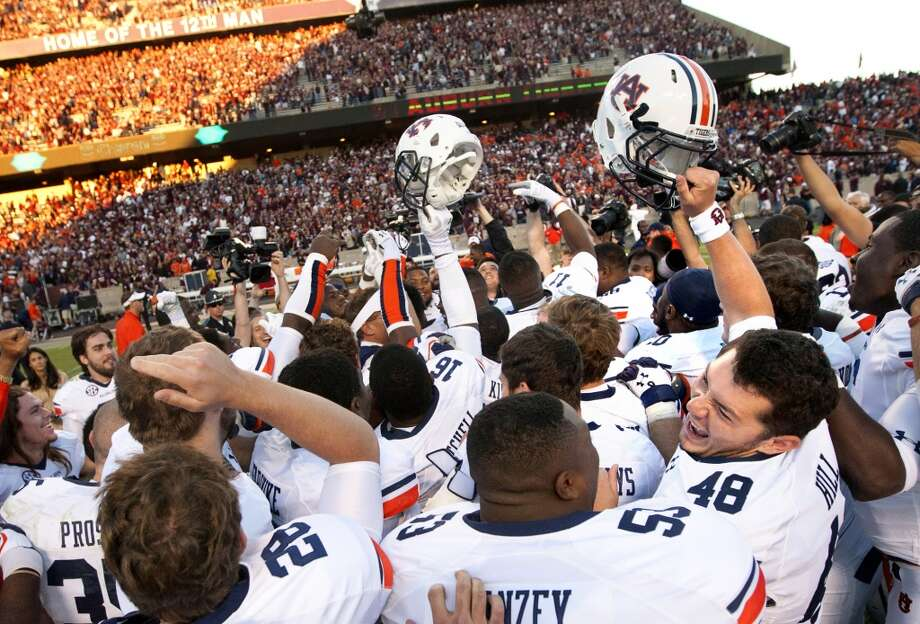 The Auburn Tigers celebrate after a 45-41 win over the Texas A&M at Kyle Field. Photo: Cody Duty, Houston Chronicle
