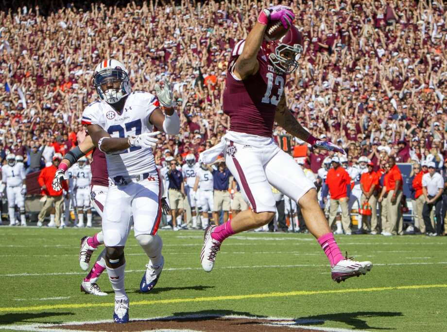 Auburn defensive back Robenson Therezie comes up short as Texas A&M Aggies wide receiver Mike Evans runs in touchdown during the first half. Photo: Cody Duty, Houston Chronicle