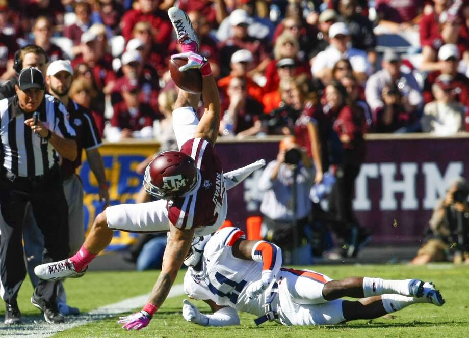 Texas A&M wide receiver Mike Evans is driven out of bounds by Auburn cornerback Chris Davis. Photo: Cody Duty, Houston Chronicle