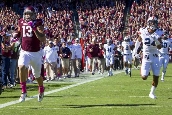 Texas A&M wide receiver Mike Evans scores on a 65-yard touchdown pass during the first quarter.