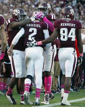 Teammates congratulate Texas A&M quarterback Johnny Manziel after he ran the ball in for a one-yard touchdown. Photo: Cody Duty, Houston Chronicle