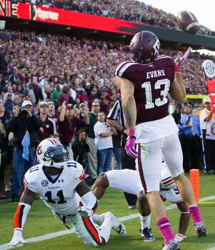 Texas A&M wide receiver Mike Evans can't make a catch in the end zone during the fourth quarter. Photo: Cody Duty, Houston Chronicle