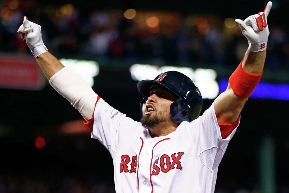 Shane Victorino exults after his seventh-inning grand slam helped Boston clinch the AL Pennant and its third World Series trip in 10 seasons. Photo: Jared Wickerham / Getty Images