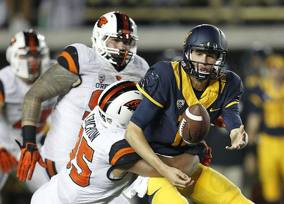 Jared Goff fumbles as he is sacked by Oregon State's Scott Crichton during the first quarter. Goff committed three turnovers before being replaced with Cal trailing 35-3. Photo: Tony Avelar, Associated Press