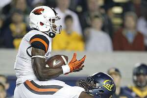 Oregon State wide receiver Brandin Cooks (7) catches a pass over California defensive back Damariay Drew (27) during the second quarter of an NCAA college football game in Berkeley, Calif., Saturday, Oct. 19, 2013. (AP Photo/Tony Avelar)