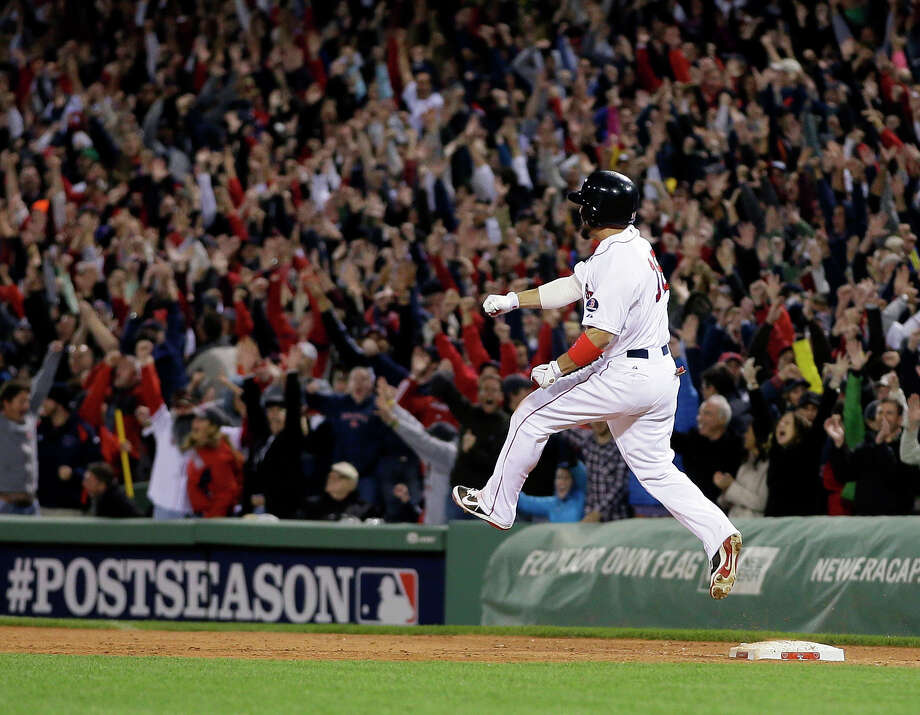 Shane Victorino is practically running on air after hitting a seventh-inning grand slam that took the Red Sox from a 2-1 deficit to a 5-2 advantage Saturday night. Photo: Matt Slocum, STF / AP
