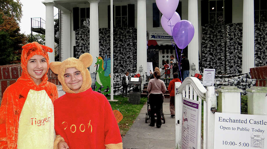 Lauren Mayo, 15, and Melissa Zaccagnino, 12, dressed as Winnie the Pooh characters at the opening Saturday of the Enchanted Castle at the Burr Homestead. Photo: Mike Lauterborn / Fairfield Citizen contributed