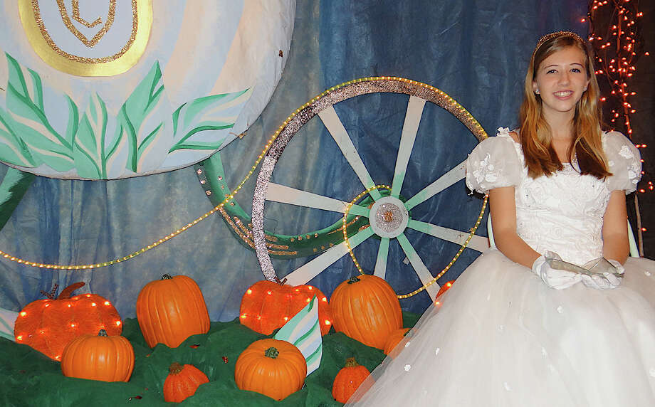 Lauren Mergenthaler, 15, is Cinderella at the opening Saturday of the Enchanted Castle at the Burr Homestead. Photo: Mike Lauterborn / Fairfield Citizen contributed
