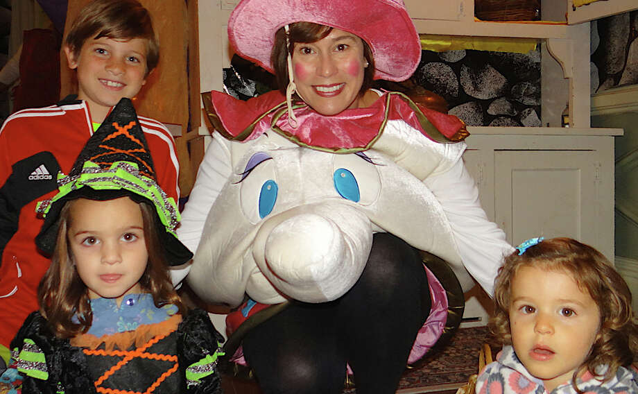At opening day of the Enchanted Castle in the Burr Homestead are ack Carden and Mia Carden, ages 9 and 4, of Fairfield; Zoe Bebon as Mrs. Potts, and Estelle Madeira, 2, of Fairfield. Photo: Mike Lauterborn / Fairfield Citizen contributed