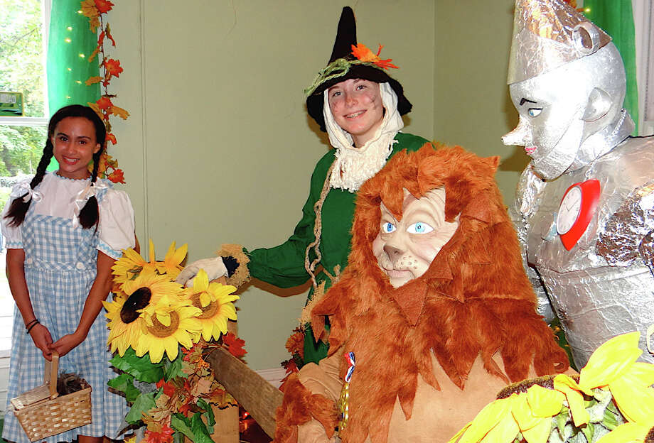 Maxine Hebert, 14, as Dorothy, and Meghan Podolski, 15, as the Scarecrow, characters from the Wizard of Oz, at the Enchanted Castle in the Burr Homestead. Photo: Mike Lauterborn / Fairfield Citizen contributed