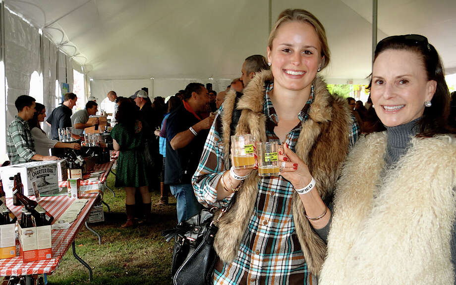 Blair Stout and her mother Sarah, of Wilton, sample beer at the Biergarten on the Green. Photo: Contributed Photo / Westport News contributed