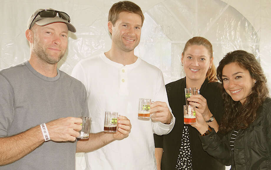 Friends enjoying beer at the Biergarten on the Green were: James McLoughlin of Norwalk, Adam Fullilove of Stamford, Sarah Fullilove of Rowayton, and Mia Forte of Norwalk. Photo: Mike Lauterborn / Westport News contributed
