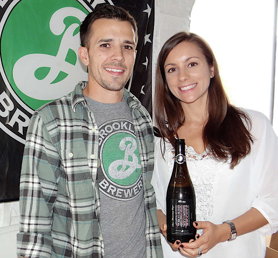 Jay Leblanc and Jessica Magner representing Lagunitas Brewing Co. and Brooklyn Brewery at Biergarten on the Green. Photo: Mike Lauterborn / Westport News contributed