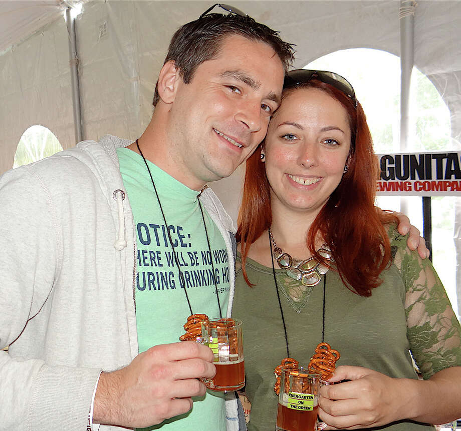 Dan Riley and Sam de Armas sampling Lagunitas beer at the 2nd annual Biergarten on the Green, sponsored by the Downtown Merchants Association Photo: Mike Lauterborn, Contributed Photo / Westport News contributed