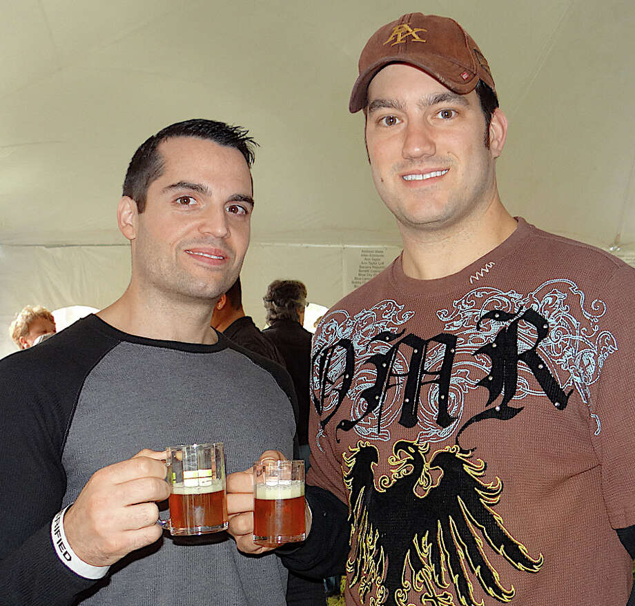 Jason Troini and Chris Braccia enjoying the Biergarten on the Green. Photo: Mike Lauterborn / Westport News contributed