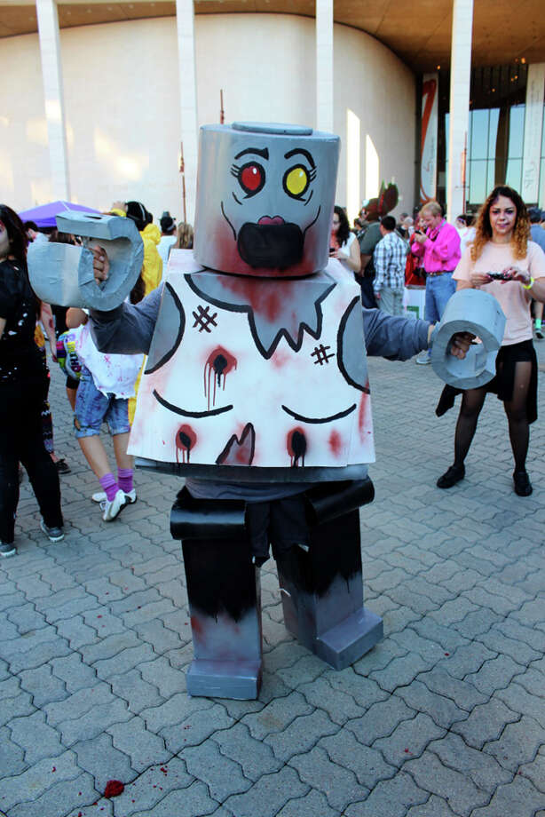 "Complete numbers aren't in yet, but organizers say more than 2,000 people participated in Saturday's fundraiser at Jones Plaza.  Proceeds went to Houston Children's Charity, Houston Humane Society and Dove Key Ranch Wildlife Rehab.  The event included a ""pub crawl"" after party at downtown bars.   www.houstonzombiewalk.org Photo: Jorge Valdez / For The Chronicle"