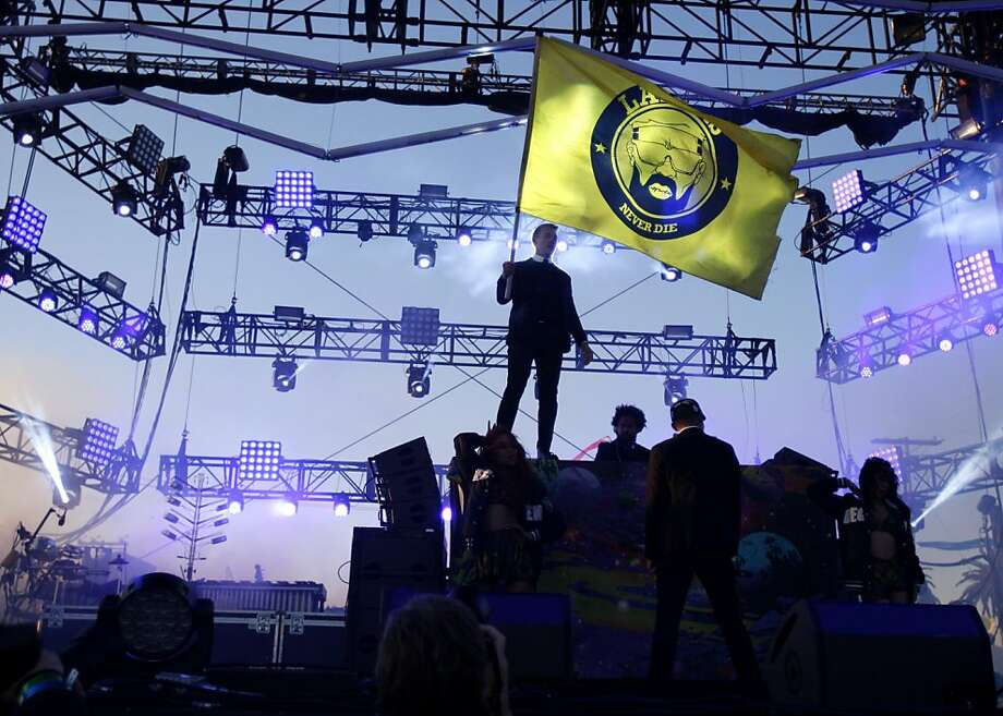 Diplo is seen holding a Major Lazer flag during their performance at the Treasure Island Music Festival in San Francisco, Calif. on Saturday, Oct. 19, 2013. Photo: Raphael Kluzniok, The Chronicle
