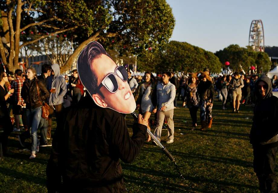 Kyle Riego De Dios carries a large cutout of his own face at the Treasure Island Music Festival in San Francisco, Calif. on Saturday, Oct. 19, 2013. Photo: Raphael Kluzniok, The Chronicle