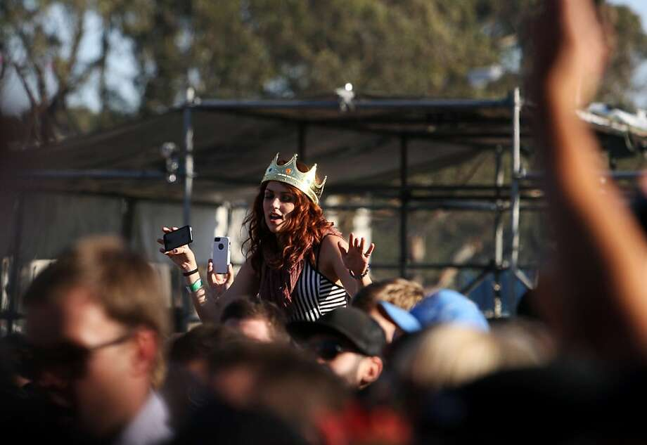 Lindsy Brewer of Morgan Hill is seen above the crowd wearing her friends birthday crown at the Treasure Island Music Festival in San Francisco, Calif. on Saturday, Oct. 19, 2013. Photo: Raphael Kluzniok, The Chronicle
