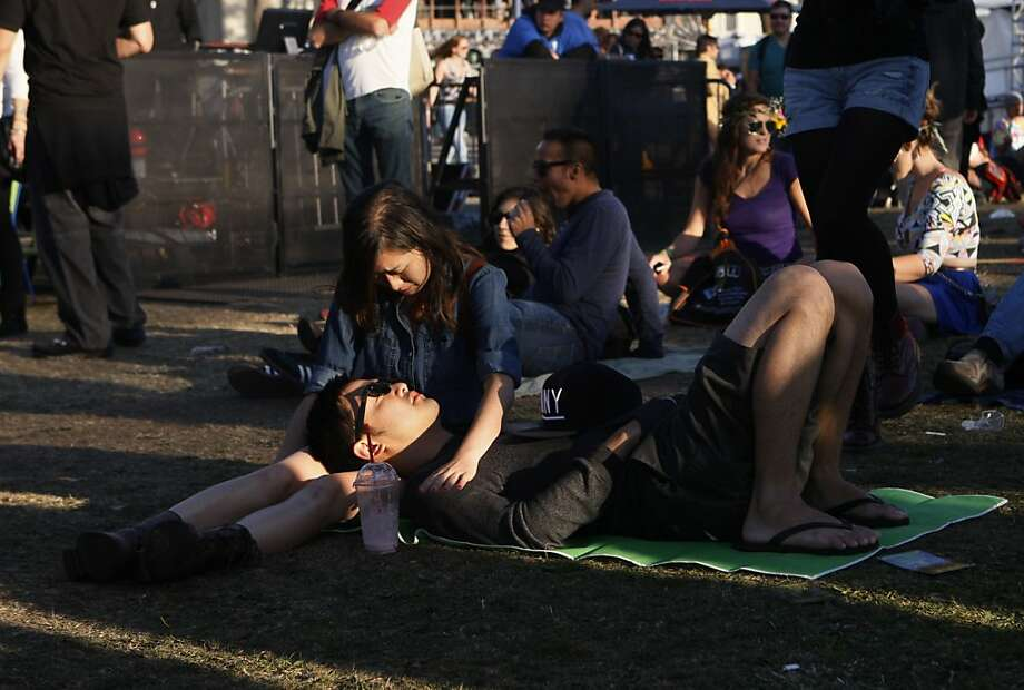 Diana Chew and Ian Chan of San Francisco relax on the grass at the Treasure Island Music Festival in San Francisco, Calif. on Saturday, Oct. 19, 2013. Photo: Raphael Kluzniok, The Chronicle