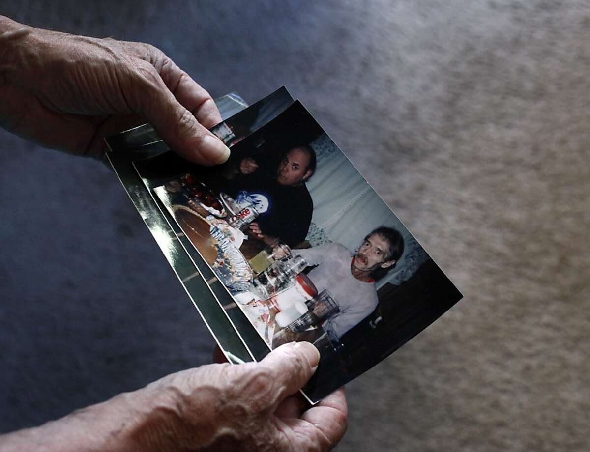 Ken McCraney, 62, looks over pictures of himself when he was in is 30's and weighing between 75 and 80 pounds, Thursday October 3, 2013, in San Jose, Calif. McCraney, who has been suffering with anorexia since he was in his teens.