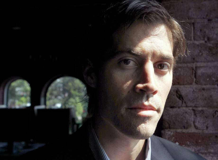 In this May 27, 2011 file photo, American journalist James Foley, of Rochester, N.H., who was last seen on Nov. 22 2012 in northwest Syria, poses for a photo in Boston. Foley's family plans to mark his 40th birthday with a plea for his safe return. His parents, John and Diane Foley, will lead a prayer vigil Friday evening, Oct. 17, 2013 at a church in Rochester. Photo: Steven Senne, AP / AP