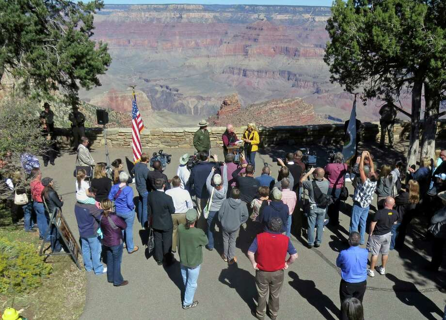 In this Oct. 12, 2013 file image provided by the National Park service, Arizona Gov. Jan  Brewer. rear center right, and park officials announce the reopening of the Grand Canyon National Park, in Arizona. The U.S. Interior Department says Congress will have to decide whether to repay states, like Arizona, that decided to re-open national parks during the partial government shutdown. Photo: Michael Quinn, AP / NPS