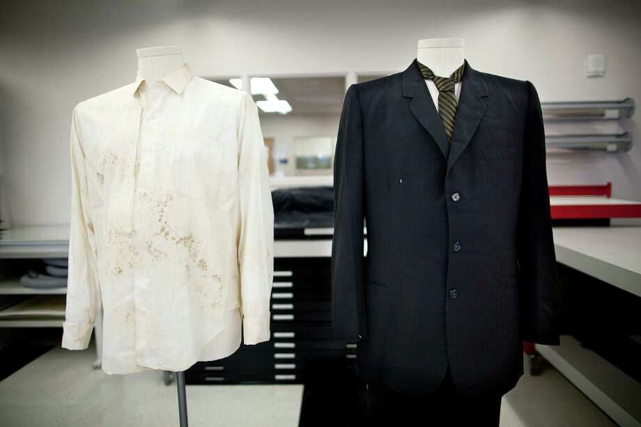 The white cotton shirt and black suit worn by Texas Gov. John Connally on the day gunfire wounded him and killed President John F. Kennedy in Dallas, Texas on Nov. 22, 1963, is pictured at the Texas State Library and Archives Commission in Austin, Texas on Tuesday, Oct. 15, 2013. Texas state archivists are preparing the suit and shirt worn by Connally as the centerpiece for an exhibit to mark next month's 50th anniversary of Kennedy's assassination.  It will be the first public display of the clothing since 1964. Photo: Tamir Kalifa, AP / AP2013