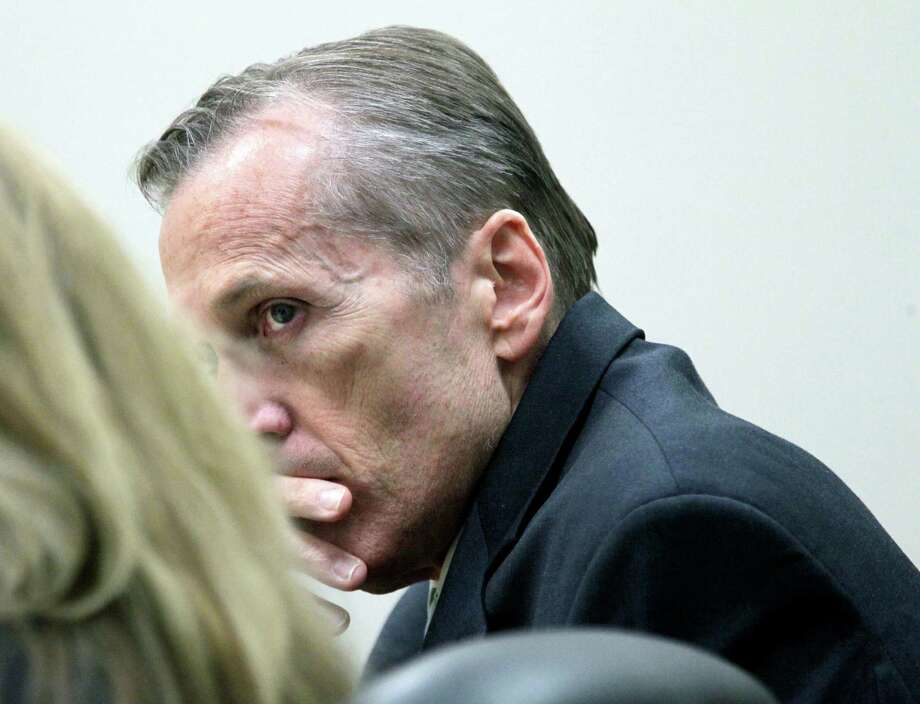 Martin MacNeill listens to witness testimony during his trial in Judge Derek Pullan's 4th District Court in Provo, Utah,  Thursday, Oct. 17, 2013. MacNeill, 57, a former doctor, is charged with murder in the 2007 death of his wife. He was charged in August 2012, nearly five years after his former beauty queen wife, Michele MacNeill, was found in the bathtub at the couple's Pleasant Grove home, about 35 miles south of Salt Lake City. Photo: Al Hartmann, AP / Pool The Salt Lake Tribune