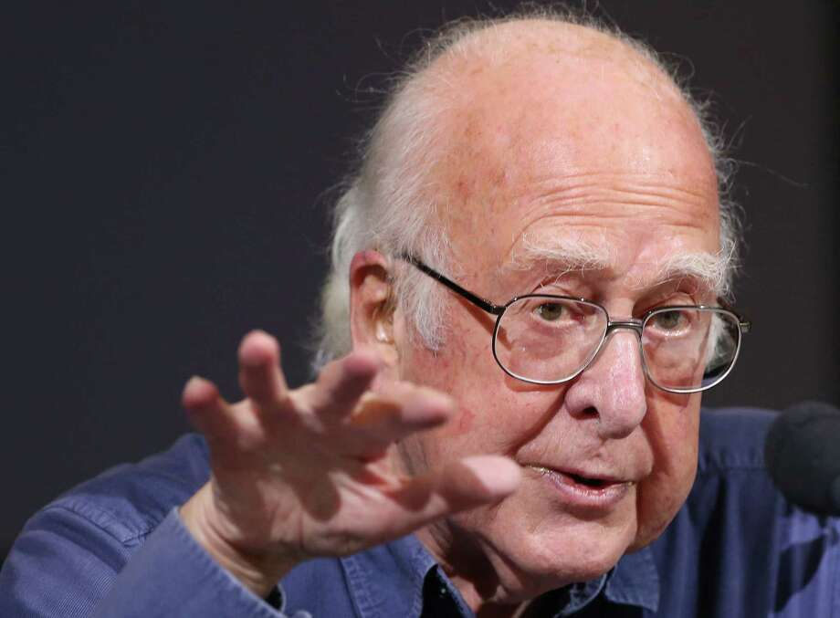 In this Friday, Oct. 11, 2013 file photo, Britain's Professor Peter Higgs gestures during a press conference in Edinburgh, Scotland. Nobel Prize winning scientist Peter Higgs told the BBC on Tuesday Oct. 15, 2013, that he is hoping to retire next year at the age of 85. Photo: Scott Heppell, AP / A2013