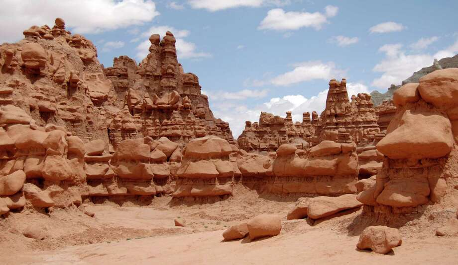 This undated photo released by Utah State Parks shows rock formations at Goblin Valley State Park. Authorities say three men could face felony charges after purposely knocking over an ancient Utah desert rock formation and posting a video of the incident online. State parks spokesman Eugene Swalberg says the formation at Goblin Valley State Park is about 170 million years old. The park is dotted with thousands of the eerie, mushroom shaped sandstone formations. The two leaders also said they have been receiving death threats for their actions (see story below). Photo: HOPD, AP / AP2006