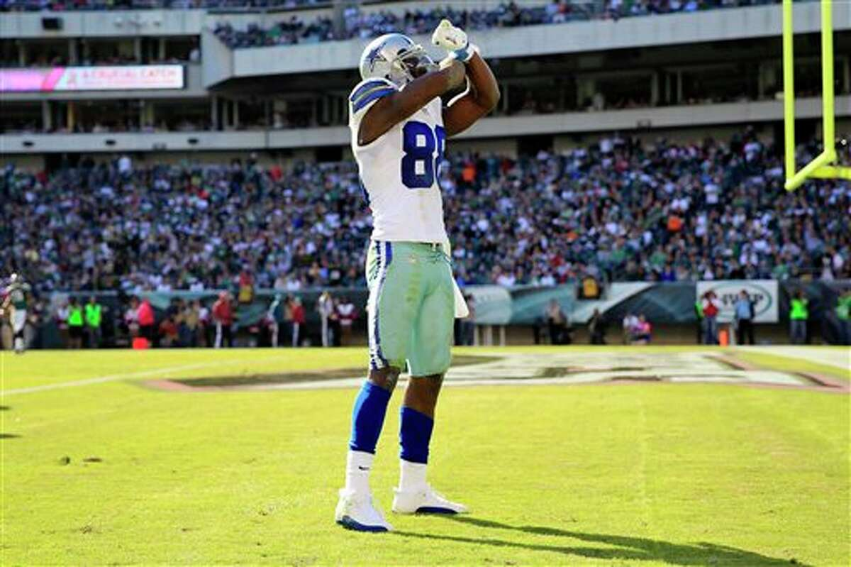 Dallas Cowboys wide receiver Dez Bryant gestures after catching a pass to put the Cowboys inside the Philadelphia Eagles 5-yard line during the first half of an NFL football game, Sunday, Oct. 20, 2013, in Philadelphia.