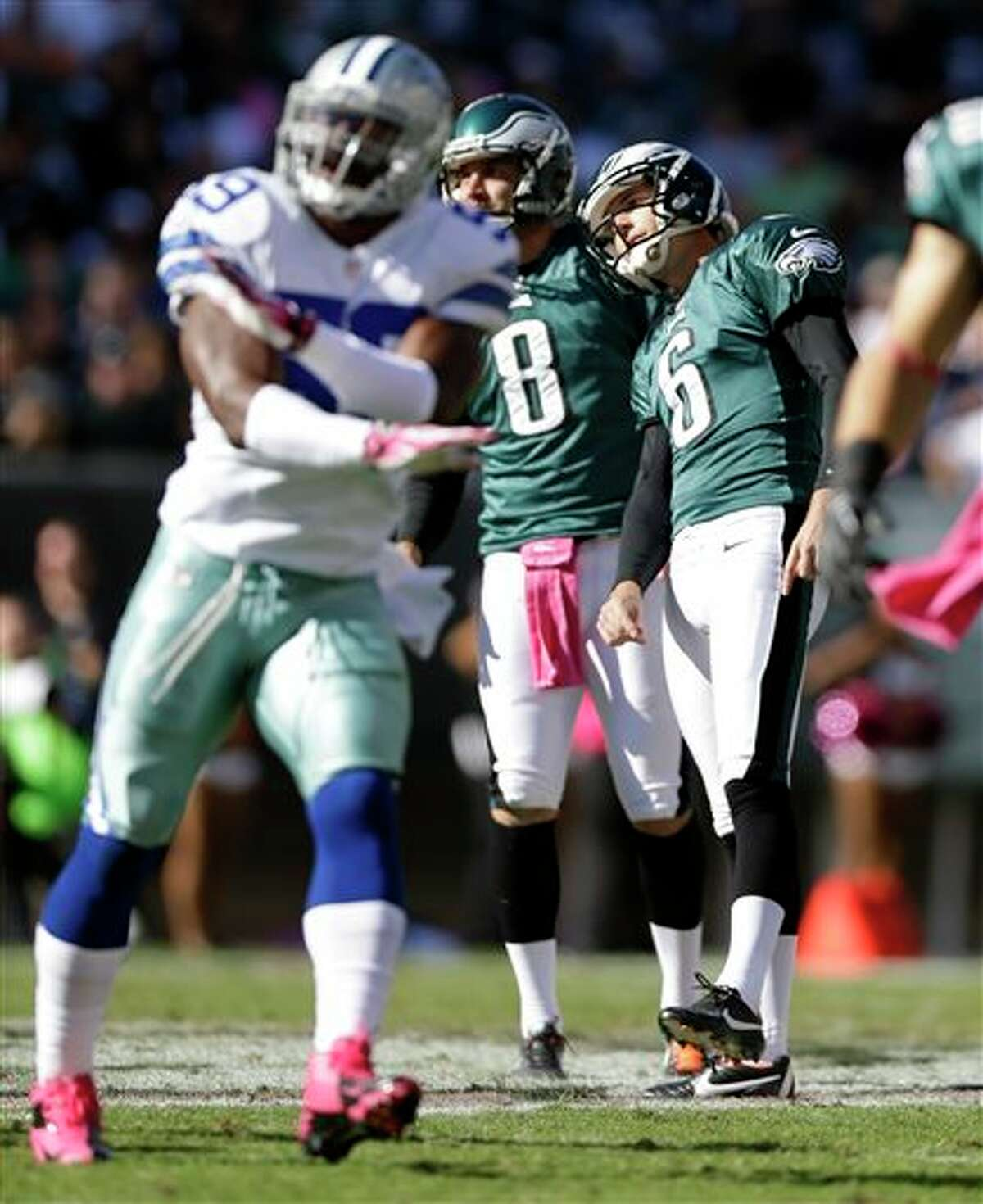 Philadelphia Eagles kicker Alex Henery (6) and placeholder Donnie Jones (8) watch Henery's missed field goal attempt as Dallas Cowboys' Ernie Sims, left, gestures against it during the first half of an NFL football game, Sunday, Oct. 20, 2013, in Philadelphia.