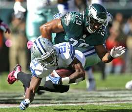 Dallas Cowboys running back Joseph Randle (21) is brought down by Philadelphia Eagles strong safety Nate Allen (29) during the first half of an NFL football game, Sunday, Oct. 20, 2013, in Philadelphia.