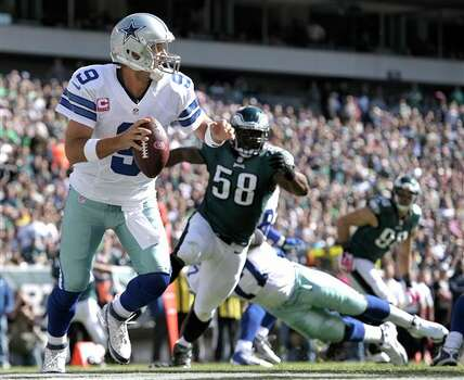 Dallas Cowboys quarterback Tony Romo (9) looks to pass as Philadelphia Eagles outside linebacker Trent Cole (58) chases him during the first half of an NFL football game, Sunday, Oct. 20, 2013, in Philadelphia. Photo: Michael Perez, AP / FR168006 AP