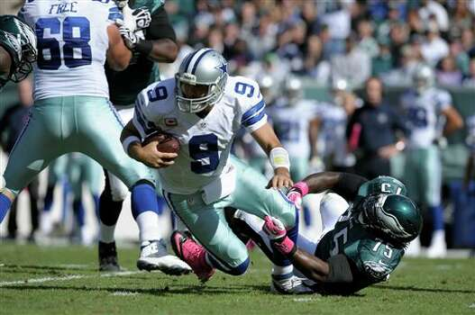 Dallas Cowboys quarterback Tony Romo (9) is sacked by Philadelphia Eagles defensive end Vinny Curry (75) during the first half of an NFL football game, Sunday, Oct. 20, 2013, in Philadelphia. Photo: Michael Perez, AP / FR168006 AP