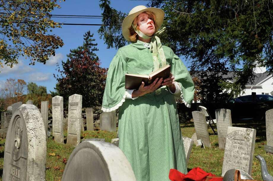 Loretta Lechner portrays Mary Osborne, who died at the age of 37, in 1875, during a Cemetry Tour presented by Perserve New Fairfield, Sunday, Oct. 20, 2013, in New Fairfield, Conn. Photo: Michael Duffy / The News-Times