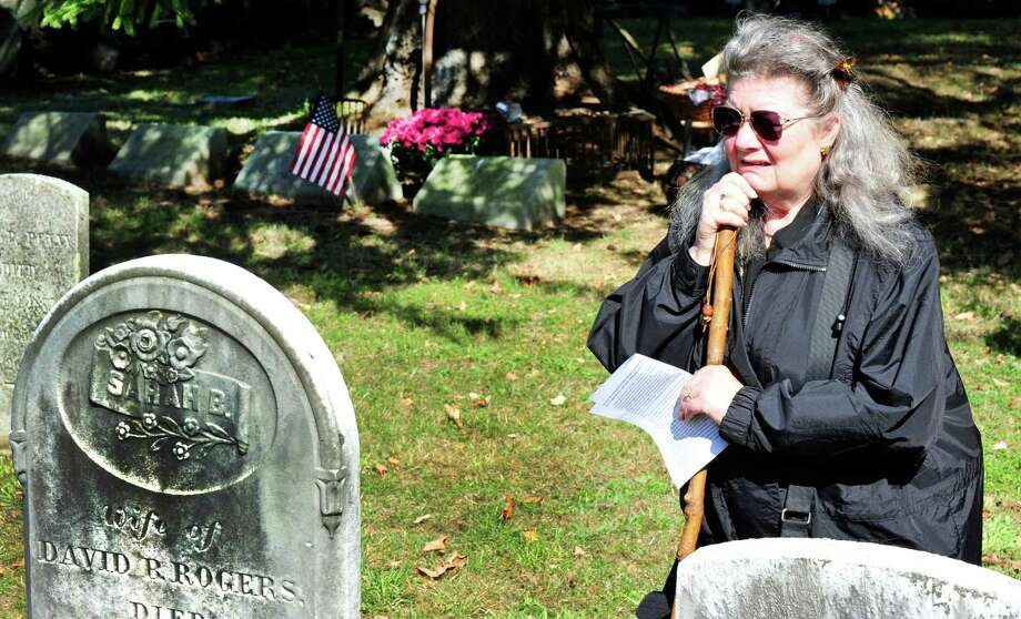 Lynda Willingham looks at the grave of David Rogers during a Cemetry Tour presented by Perserve New Fairfield, Sunday, Oct. 20, 2013, in New Fairfield, Conn. Photo: Michael Duffy / The News-Times