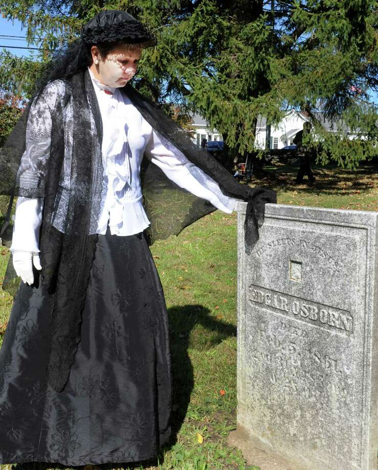 Mary Carneiro portrays Sarah Jane Brooks Potter during a Cemetry Tour presented by Perserve New Fairfield, Sunday, Oct. 20, 2013, in New Fairfield, Conn. Photo: Michael Duffy / The News-Times