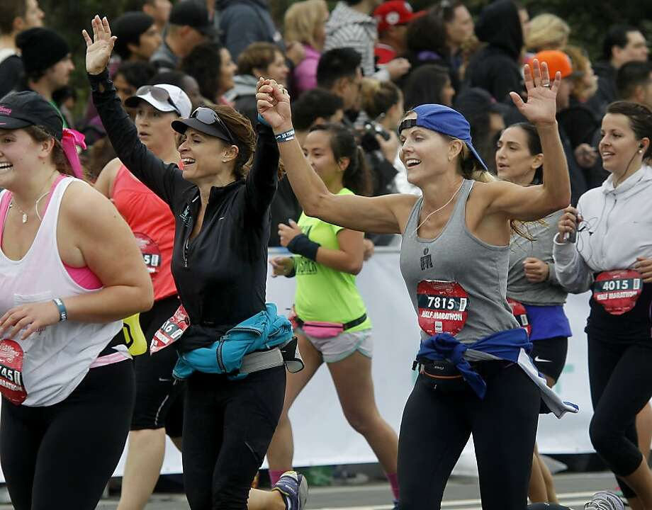 Half marathon finishers celebrated as they approached the finish line Sunday October 20, 2013 in San Francisco, Calif. Thousands of women and a few men took part in the annual Nike Women's Marathon which began at Union Square and finished along the Great Highway. Photo: Brant Ward, The Chronicle