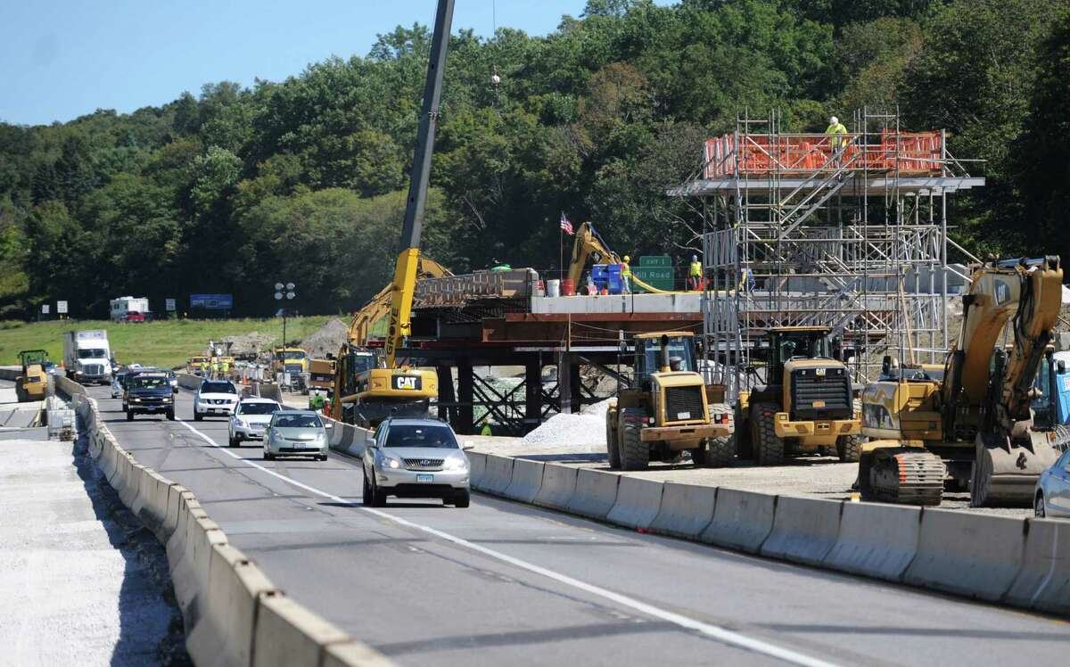 Construction crews work on the new bridge on I-84, just across the border in Brewster, N.Y. on Wednesday, Sept. 18, 2013. The existing bridge over Dingle Road will be demolished and a new prefabricated bridge will be put in its place this weekend. I-84 westbound will be closed for much of the weekend because of the construction.