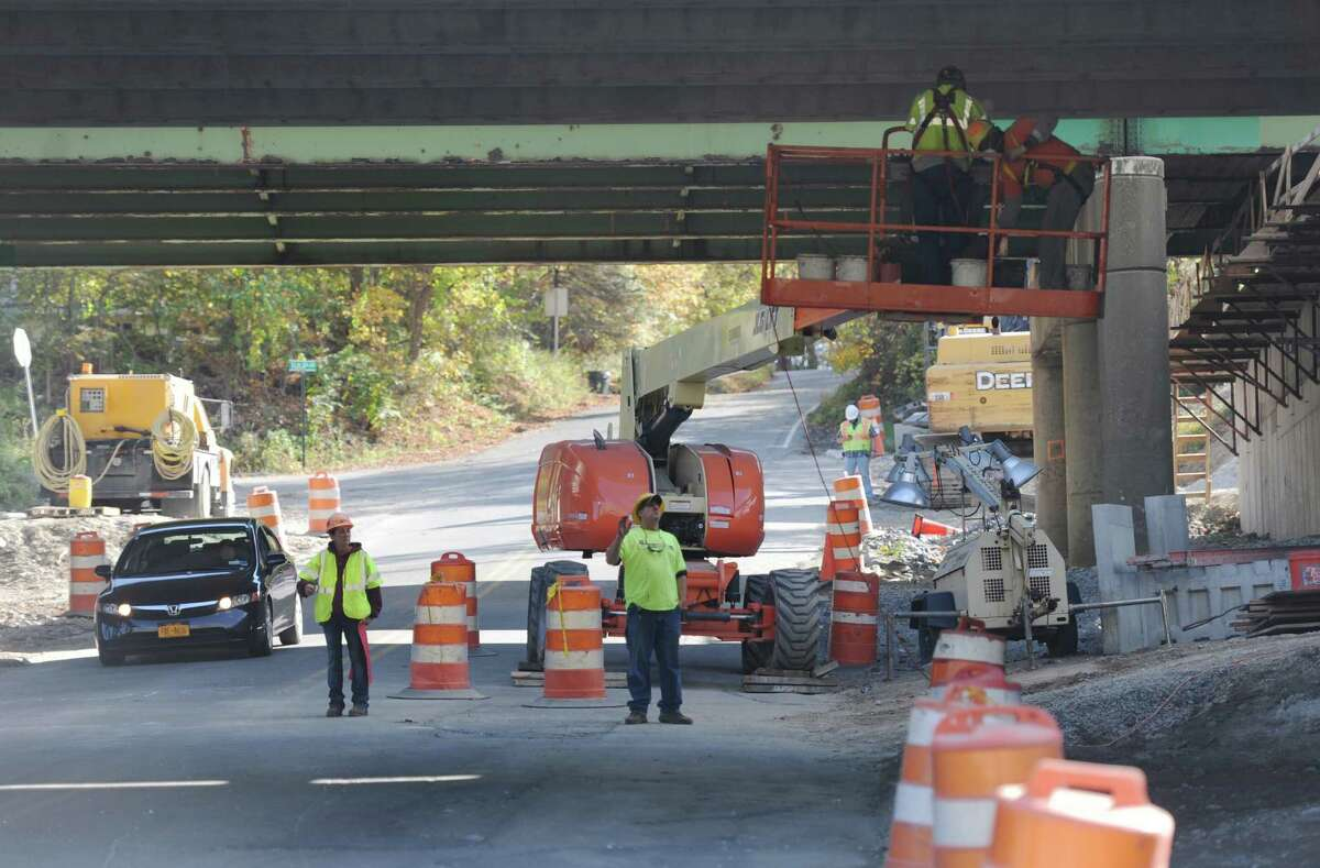 A construction crew works on the bridge along I-84, crossing Dingle Ridge Road, in Southeast, N.Y. on Tuesday, Oct. 15, 2013. I-84 eastbound will be closed this weekend as the crew slides the new bridge into place, expecting to cause delays. The anticipated timeframe is from 5 p.m. Saturday until noon Sunday.