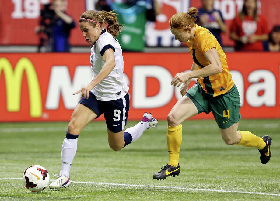 United States of America's Heather O'Reilly and Australia's Clare Polkinghorne chase after the ball during first half action of an international friendly soccer match Sunday Oct. 20, 2013 at the Alamodome. Photo: Edward A. Ornelas, San Antonio Express-News / © 2013 San Antonio Express-News