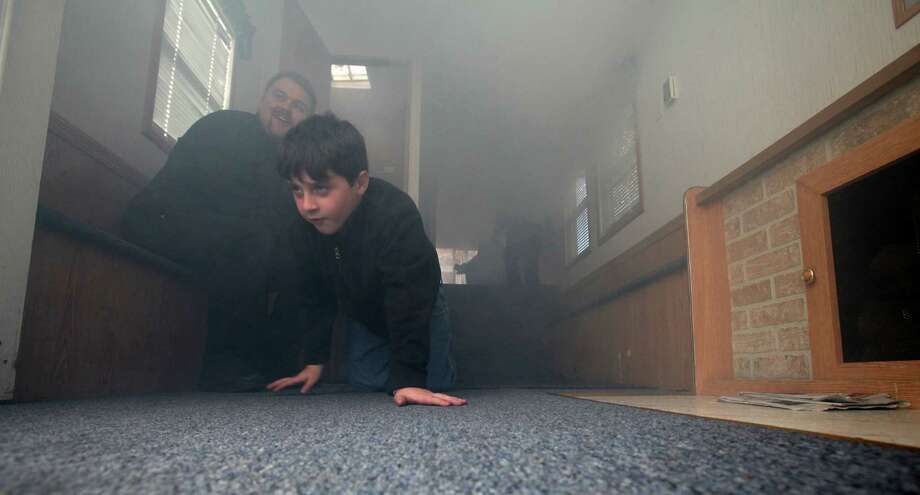 Mathew Spielman, 7,  of Trumbull, crawls through a fire prevention trailer, from Westport, at the Long Hill Volunteer Fire Dept.'s annual open house in Trumbull, Conn. on Sunday, Oct. 20, 2013. Photo: Unknown, B.K. Angeletti / Connecticut Post freelance B.K. Angeletti