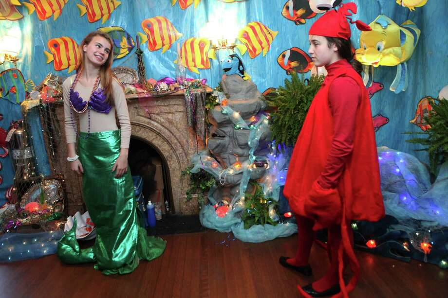 Julia Rachel, 13, left, and Rachel Portnay, 12, tell the story of The Little Mermaid during the 20th year of The Enchanted Castle at the Burr Mansion in Fairfield, Conn. on Sunday, Oct. 20, 2013. It is open Wednesday October 23 through Tuesday October 29. The event benefits the  Ahlbin Centers for Rehab. Photo: BK Angeletti, B.K. Angeletti / Connecticut Post freelance B.K. Angeletti