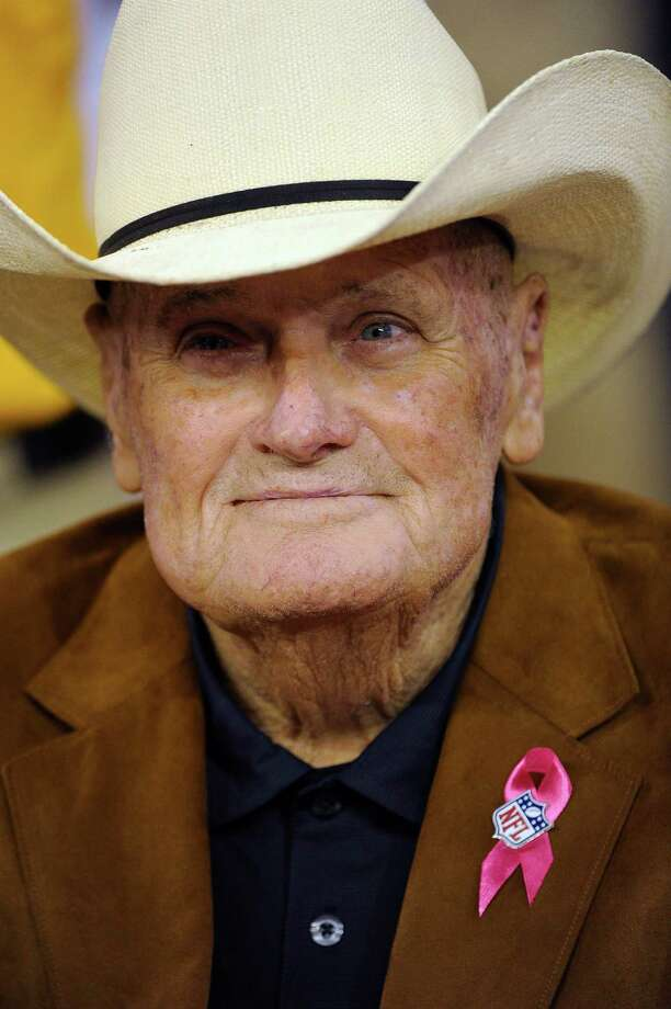 In this Oct. 14, 2012, photo, Former Houston Oilers coach Bum Phillips watches from the bench before an NFL football game between the Green Bay Packers and the Houston Texans in Houston. Phillips, the folksy Texas football icon who coached the Houston Oilers and New Orleans Saints, died Friday, Oct. 18, 2013. He was 90. (AP Photo/Dave Einsel) Photo: Dave Einsel, FRE / FR43584 AP
