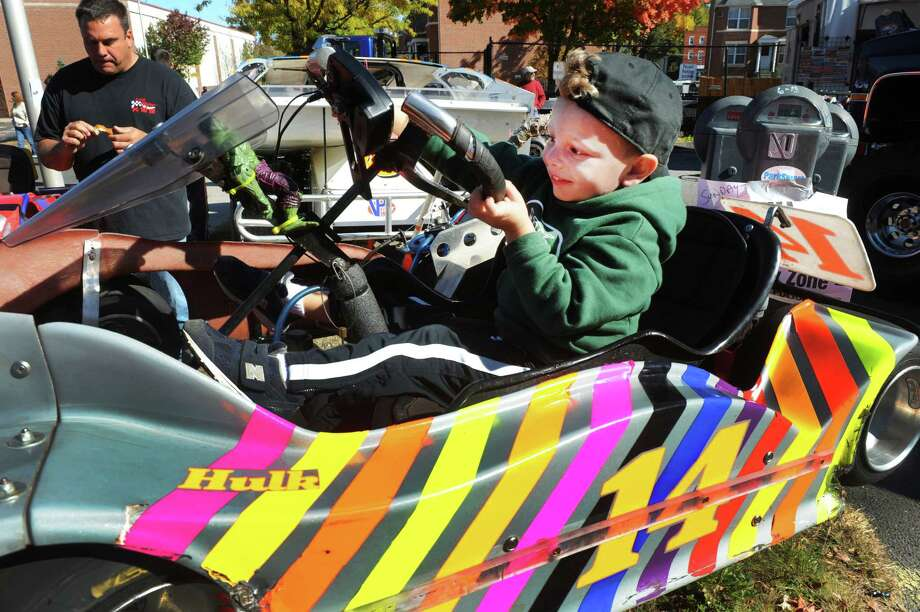 "Joe Ferrante, 3, sits behind the wheel of a go-kart during a "" Classic Car & Bike Show on Main Street""  takes place in Danbury, Conn. Sunday, Oct. 20, 2013. In the tradition of previous ""Karing for Kelly"" events, the charity event is hosted by Lew Lombardo's Ultimate Restorations LLC, and George Korres's Nico's Pizza and Pasta, to benefit Danbury firefighter Joe LaDuca, who is suffering malignant brain tumors. Photo: Michael Duffy / The News-Times"